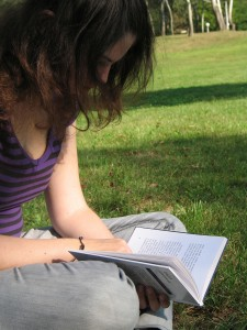 Girl reading a book outside