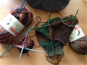 Two unfinished sock knitting projects