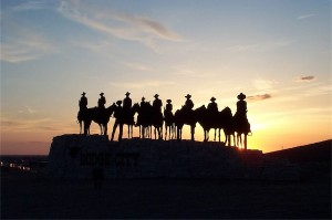 Cowboys silhouetted against sunset; image by Donna Hyora on StockExchange